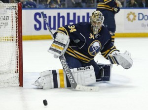 Feb 26, 2015; Buffalo, NY, USA; Buffalo Sabres goalie Michal Neuvirth (34) makes a save on a shot by the Vancouver Canucks during the third period at First Niagara Center. Sabres beat the Canucks 6-3. Mandatory Credit: Kevin Hoffman-USA TODAY Sports