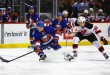NY Islanders Ryan Pulock gets by NJ Devils Reid Boucher.(Brandon Titus/Inside Hockey)