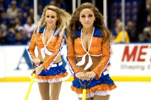 Uniondale, NY. New York Rangers vs New York Islanders. New York Islanders Ice Girls clear the rink of snow and debris during the intermissions and time outs. Tuesday October 29th 2013 (Photo by Anthony Causi)