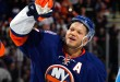 UNIONDALE, NY - JANUARY 16:  Kyle Okposo #21 of the New York Islanders is named the first star of the game for his four goals against the Pittsburgh Penguins at the Nassau Veterans Memorial Coliseum on January 16, 2015 in Uniondale, New York. The Islanders defeated the Penguins 6-3.  (Photo by Bruce Bennett/Getty Images)